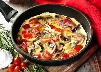 Olu kultenis ar šampinjoniem un tomātiem