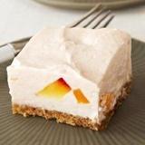 Krēmsiera – persiku kūka